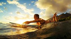 Paddling for it - posed by a surfer - Susan Jane White is on her way to being this good