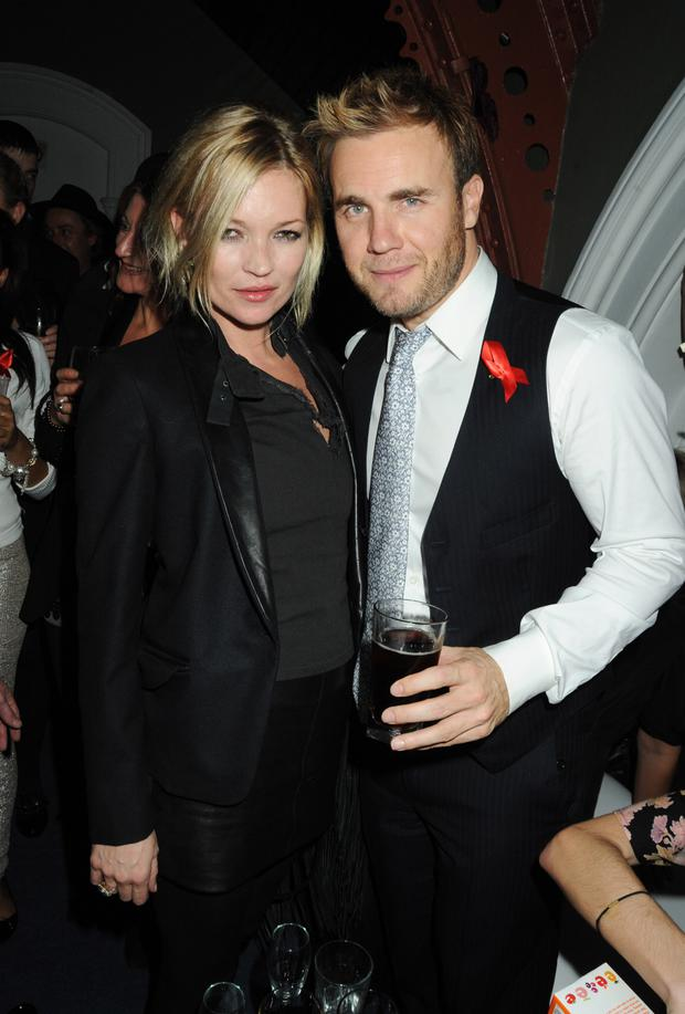 Gary poses with supermodel Kate Moss in London in 2009
