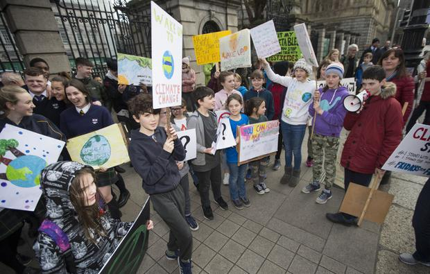 School children outside Dáil Éireann during one of the Fridays for Future protests. Photo by Colin O'Riordan