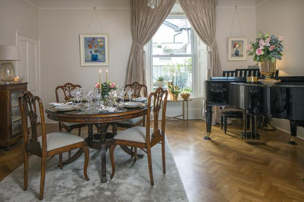 The dining room looks on to the courtyard at the back of the house. The grand piano is Darbhaile's.