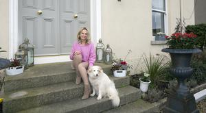 Darbhaile with her rescue dog, Blondie, on the steps of her period home in Greystones. Dating from 1865, the house boasts a majestic driveway, and is double-fronted.