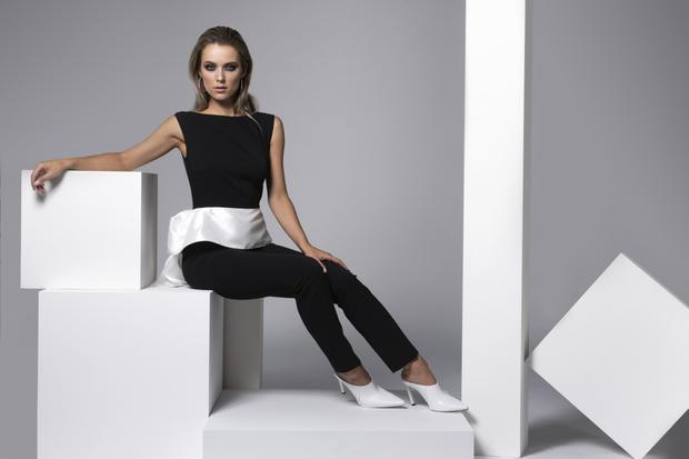 'Thompson' jumpsuit in black crêpe with white taffeta peplum, €197, also available in red from the 'Sisters' collection. Full list of stockists available from carolinekilkenny.com