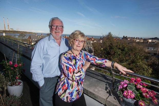 Huge benefits: Myles McWeeney and his wife Laurie Cearr only moved 800m to an apartment in Sandymount, Dublin. Photo by Mark Condren