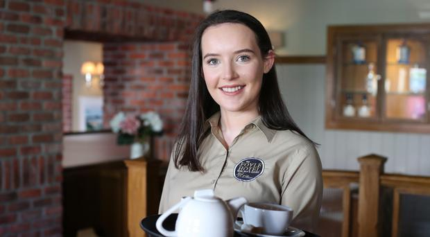 Niamh McDermott, who works part-time in The Foyle Hotel in Moville, says her job provides a welcome break from studying. Photo: Lorcan Doherty