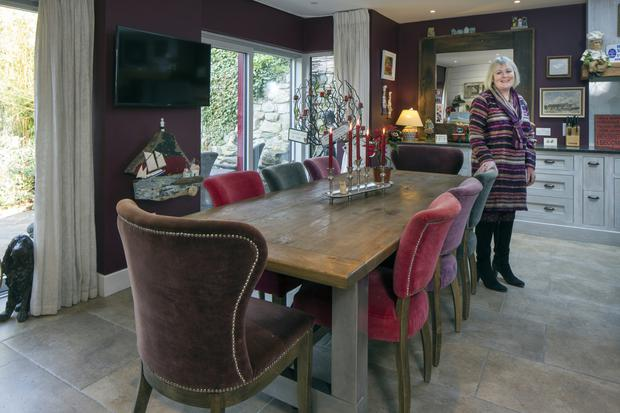 Michele in the dining area of the extension. The floor tiles are from the family company TileStyle, naturally