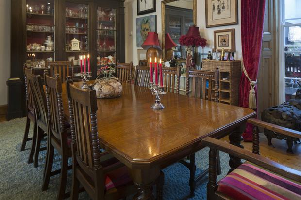 The dining room with its window, which looks into the kitchen extension and doubles as a hatch when Michele is entertaining. The dining table and chairs were her late father's