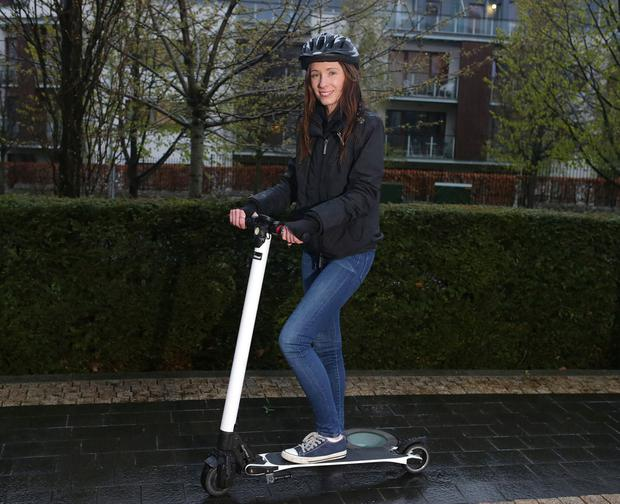 Kristina Feeney with her electric scooter. Photo: Damien Eagers / INM