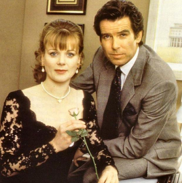 Samantha as Miss Moneypenny with 007 Pierce Brosnan in Tomorrow Never Dies