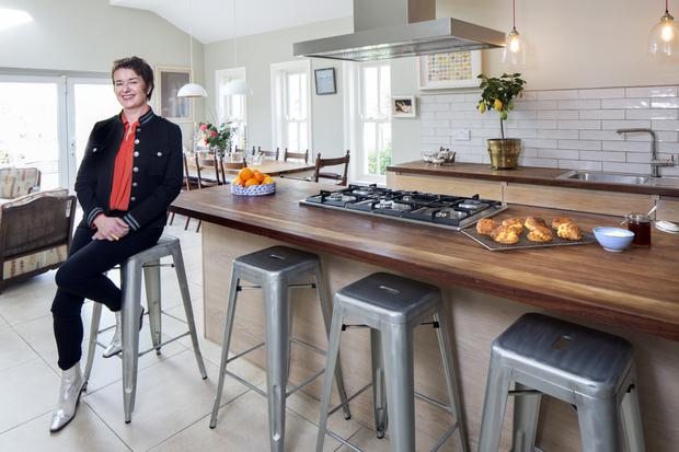 Catering supremo Eunice Power in the kitchen extension she added to her large neo-Georgian home five years ago. She opted for oak units, as her catering kitchen is all stainless steel. The wall-hanging with squares of different coloured ceramics is from the pottery shop in Ardmore