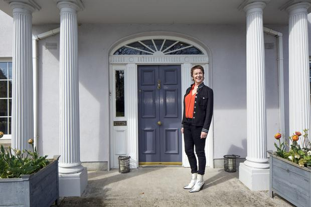Eunice outside the entrance of her neo-Gerogian home in Dungarvan which she and her husband built in the early 2000s