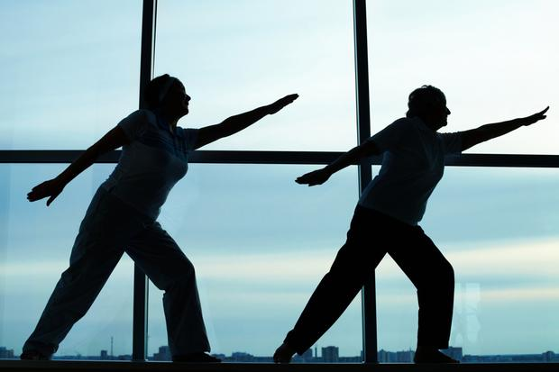 Get moving: It's a good idea to work yoga or Pilates into your fitness regime. Stock Image