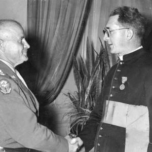 Honour: Lieutenant General John CH Lee presenting the US Medal of Freedom to Monsignor Hugh O'Flaherty in 1946