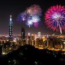 The capital of Taiwan in festive mood, with Taipei 101 standing tall over the city as the good luck rockets crackle