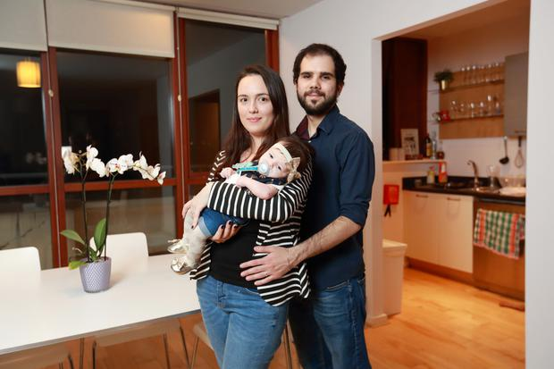 Leonardo with his partner Tabata and their two-month-old daughter Stella in the apartment they rent in Rathfarnham. Picture by Frank Mc Grath