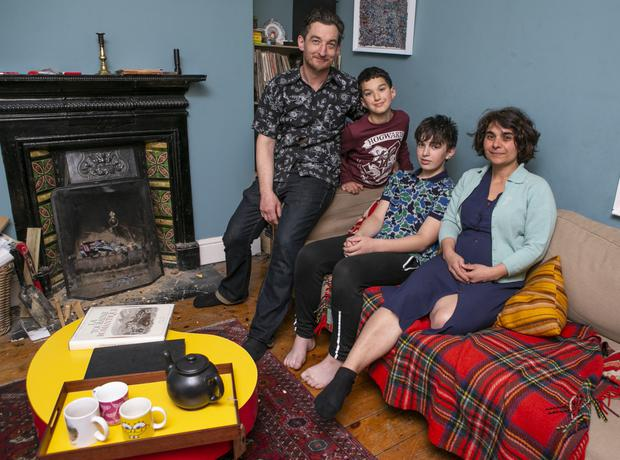 Aengus Hennessy with his wife Latifa Krim and sons Deedee (12) and Oisin (9) at their home in Decourcey Square. Photo by Kyran O'Brien