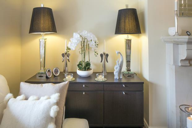 Mags loves symmetry, hence the two lamps, the twin candlesticks and the two tealight holders on the sideboard.