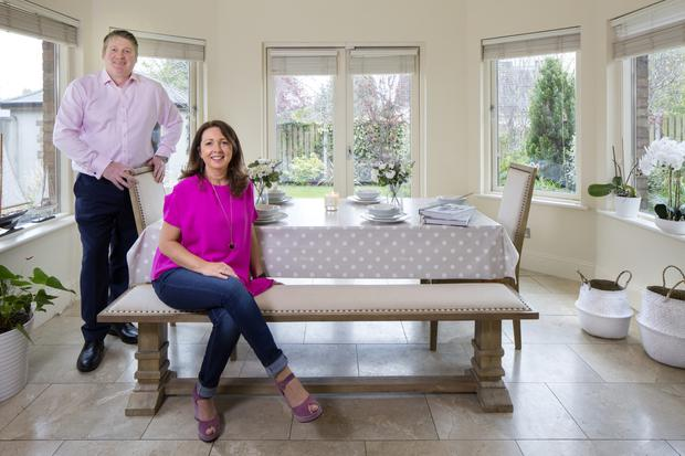 Ross Power and Mags Mallon in the sun-filled dining area. The couple work from home, and look at all properties to be staged together. Ross tends to concentrate on practical details, while Mags is all about the look of the decor