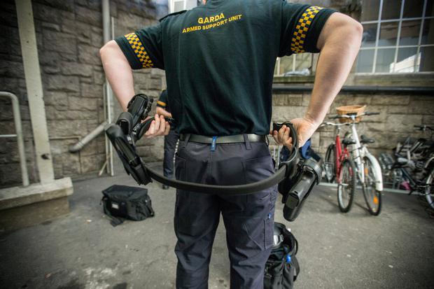 Ready for action: A member of the Garda Armed Support Unit getting ready to take to the streets of Dublin. Photo by Mark Condren