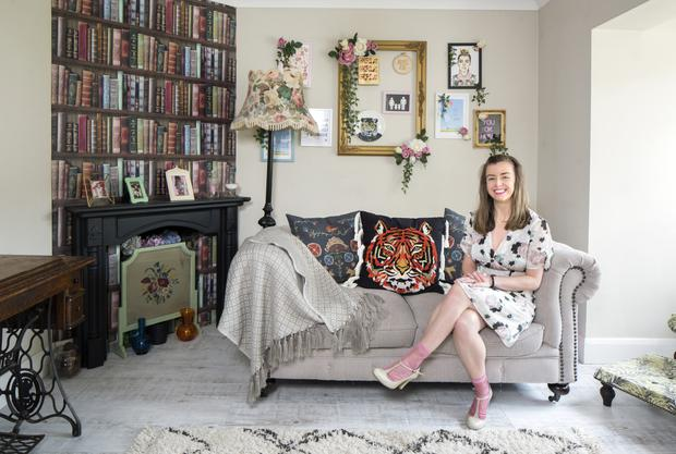 Katrina in the playroom which she has decorated with her usual mix of new pieces and junk-shop finds. The 'bookshelf' over the mantlepiece is actually wallpaper