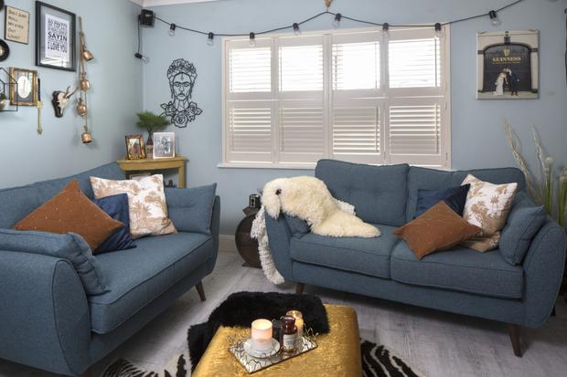The sofas in the living room are by DFS. Katrina covered the footstool, which she got from a friend in England