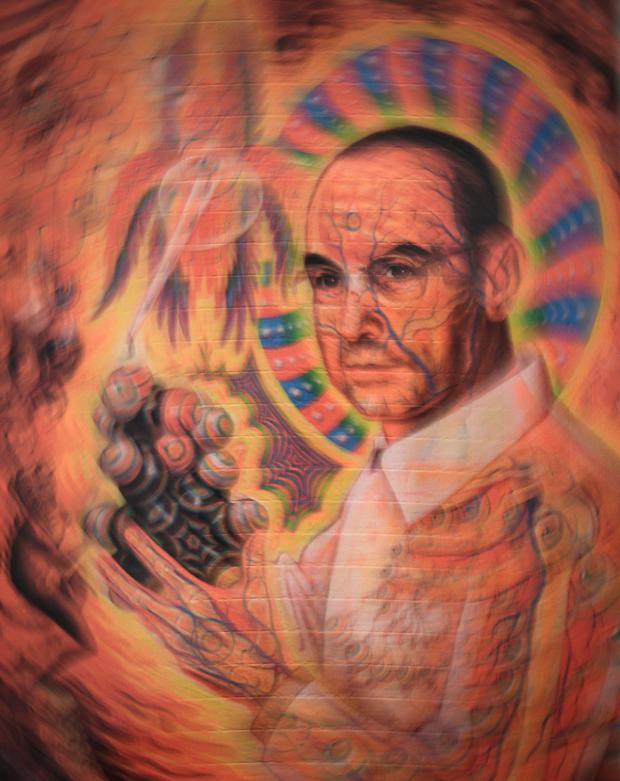A portrait of late Swiss chemist Albert Hoffman Packages is seen on a collection of LSD blotting paper shown during an exhibition entitled