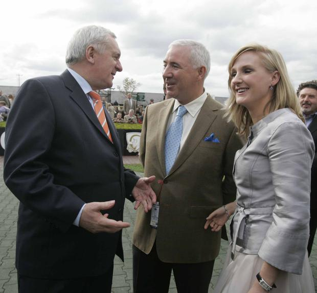 The couple with former Taoiseach Bertie Ahern at the Punchestown Festival in 2008. Photo: Eamonn Farrell/Photocall Ireland.