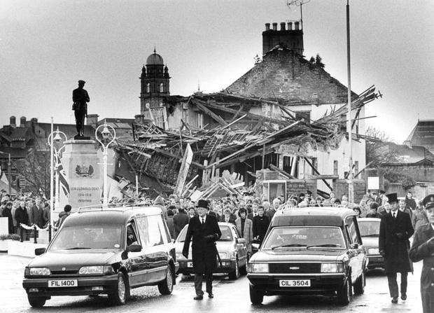 Height of the Troubles: the funeral in 1987 of two of the victims of the Enniskillen bombing by the IRA moves past the town's cenotaph and scene of explosion which killed them