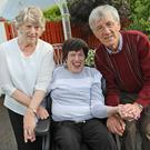 Full-time carers: Kathleen and Austin Hands with their daughter Emma at their home in Belturbet, Co Cavan. Photo: Lorraine Teevan