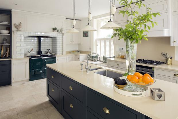 The refurbished kitchen in Sarah Gallagher's period home. Sarah opted for country-style units in keeping with the Aga, which was in the house when she and her husband, Conor, bought it. The island top is Silestone. The window seat is one of Sarah's touches - it means family and friends can chat to her as she cooks