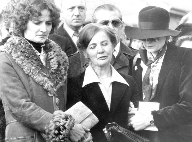 Ingeborg Niedermayer is comforted by her daughters Gabriele, left, and Renate at Thomas's funeral in 1980. Later on the three woman would take their own lives