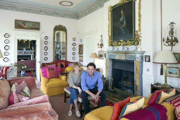 Catherine FitzGerald and her husband, actor Dominic West, in the pink room - a room kept for adults during Catherine's childhood, but their own kids are given free rein of the whole castle. Photo: Tony Gavin