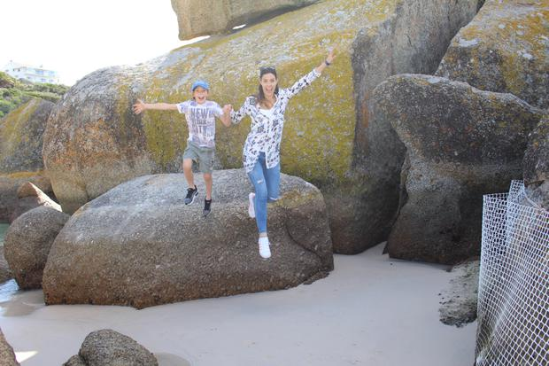 Jumping for joy at Boulders Beach, where we saw the penguins, just off the plane and ready for adventure