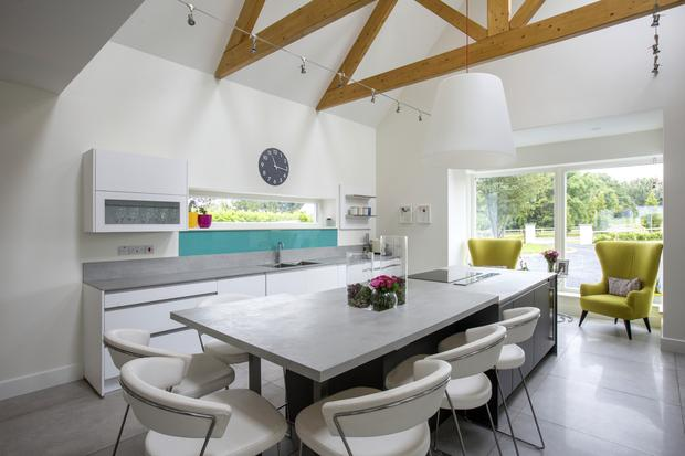 The kitchen to the front of Karl Slyne and Val O'Neill's new home is part of a big open-plan space. The ceiling is vaulted, and with the large expanses of glass, the whole area is full of light