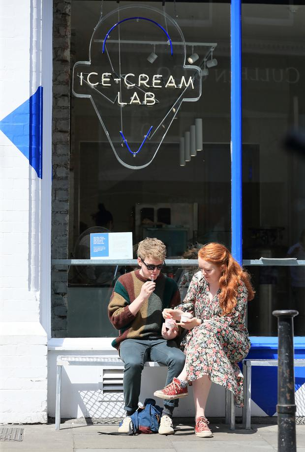 Ian Cleary and Ailbhe Griffen enjoying a treat from the Twenty Three Ice-Cream Lab. Photo: Frank McGrath
