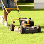 Life has become so less complicated since the invention of the robotic lawn mower – or so Husqvarna's advertising goes. Stock Image