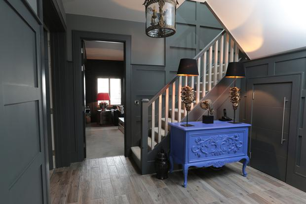 The panelling effect in the hall, as elsewhere in the house, was Lynn's partner Aidan's idea, and it really adds depth to the decor