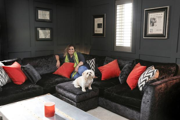 Lynn in her sitting room with her beloved cockapoo, Susie, who gets on famously with Shay. Lynn loves pops of colour - orange is her favourite bright colour at the moment