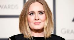Making it work: Adele and her ex have agreed to joint custody of their only son