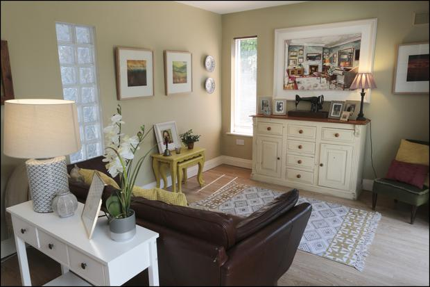 The family room off the kitchen is home to several family mementos, including the bell use's sewing machine.