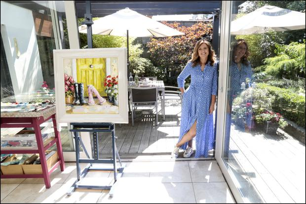 Roisin in the studio side of her kitchen extension. As an artist, she's particularly known for her series depicting wellington boots. Just beyond the glass doors is a lovely deck where Roisin and her girls eat when the weather permits. Photo: David Conaghy