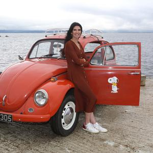 Journalist Kathy Donaghy with her 1971 VW Beetle. Photo by Lorcan Doherty
