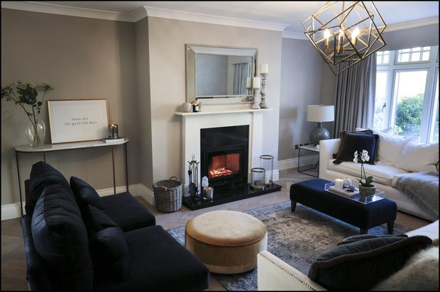 Pat opted for more colour in the furnishings in the more formal living room. The sofas in both living rooms are Irish made. She likes to decorate walls and tables with framed letters, words and motifs. Examples inlcude framed Irish words like gra and sonas - love and happiness