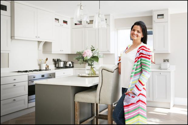 Pat Kane, owner of Reuzi, in her kitchen from BeSpace, with its Silestone worktop. There is herringbone flooring throughout the ground floor