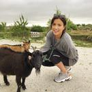 Holly Carpenter pets the goats in Monte da Estrela, Alentejo