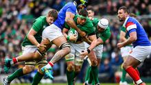 CJ Stander supported by Ireland team-mates Iain Henderson, left, and Rory Best, is tackled by Gregory Alldritt of France during the 2019 Guinness Six Nations Rugby Championship match at the Aviva Stadium in Dublin. Photo by Ramsey Cardy/Sportsfile