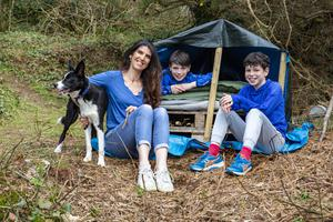 The great outdoors: Kathy and her sons Oirghiall (8) and Dallan (11), Wyatt the dog, and the den they made. Photo: Lorcan Doherty