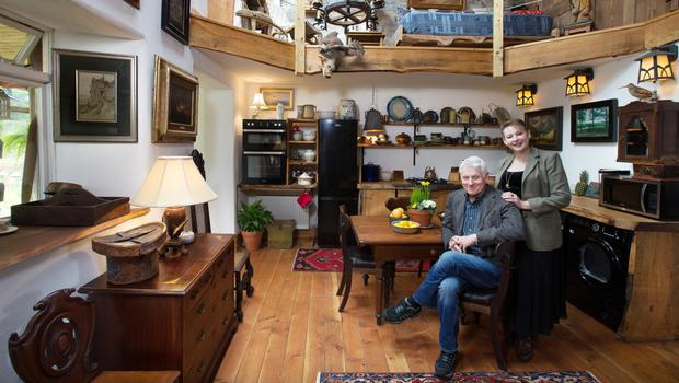 Brian and Jane in the kitchen area. The table was left in the house by the previous owner. The chest of drawers and the hatbox were bought at Stuart Auctions in Enniskillen. 'Stuart Auctions is a whole other world;we're addicted to it,' Jane notes with a laugh