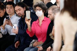 A guest wears a protective mask at the Y/Project in Paris. Photo: Getty Images