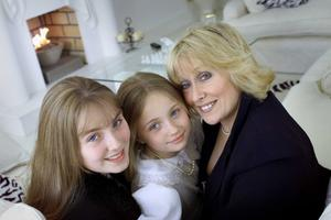 With daughters Chloe and Naomi in 2002