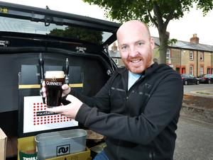 An overjoyed Eoin with his Guinness. Photo: Frank McGrath